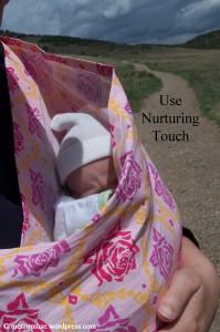 Newborn in a sling
