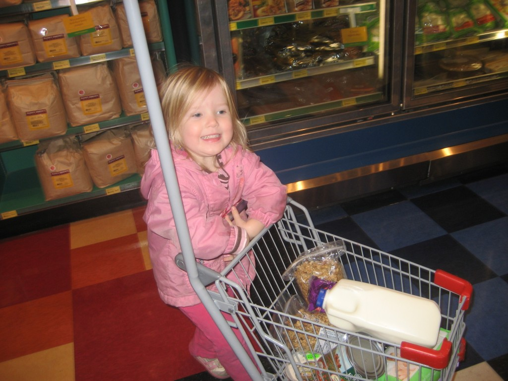 My daughter Hannah, pushing her own shopping cart