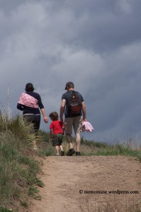 Family hiking on trail