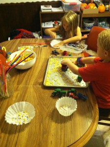 kids making crafts and Nathan harvesting corn - 2015